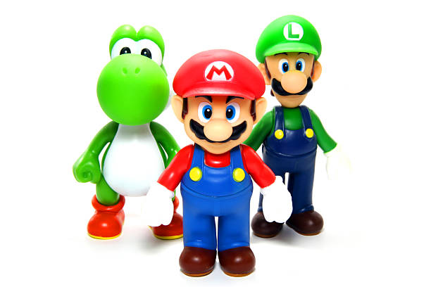 Crack Team Vancouver, Canada - April 9, 2012: Mario, Luigi and Yoshi from the Nintendo Super Mario franchise of games, posed against a white background. The toys are from Banpresto Company. nintendo stock pictures, royalty-free photos & images