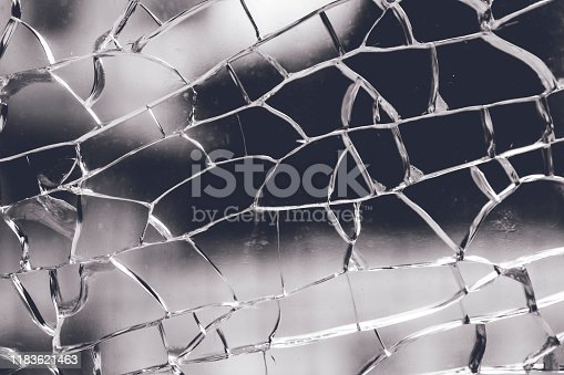 882262948 istock photo A cracked and broken glass window 1183621463