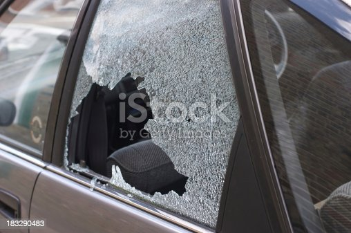 istock Thief broken glass in car window 183290483