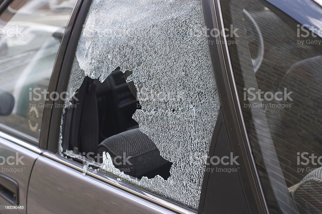 Thief broken glass in car window stock photo