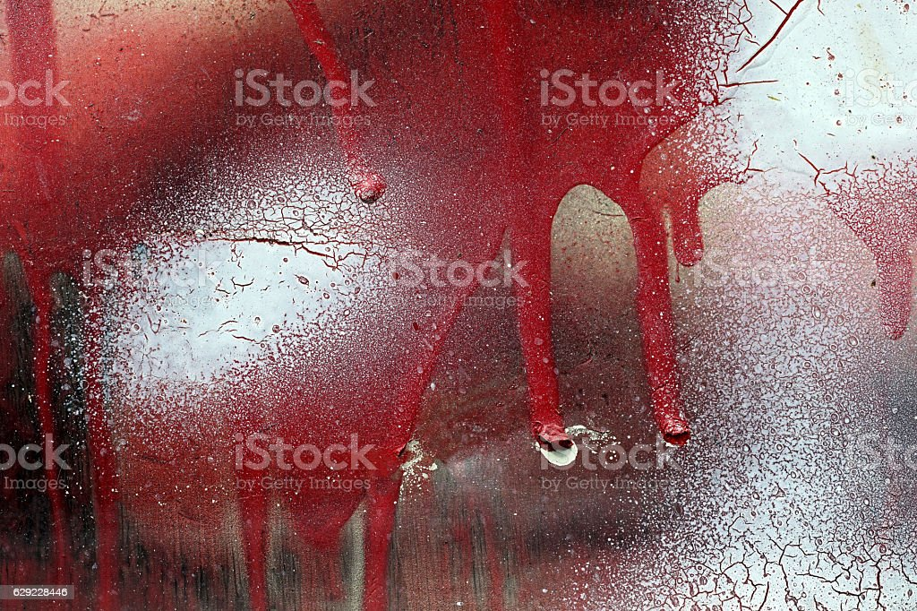 Cracked and dripping red and white paint on grunge metal stock photo