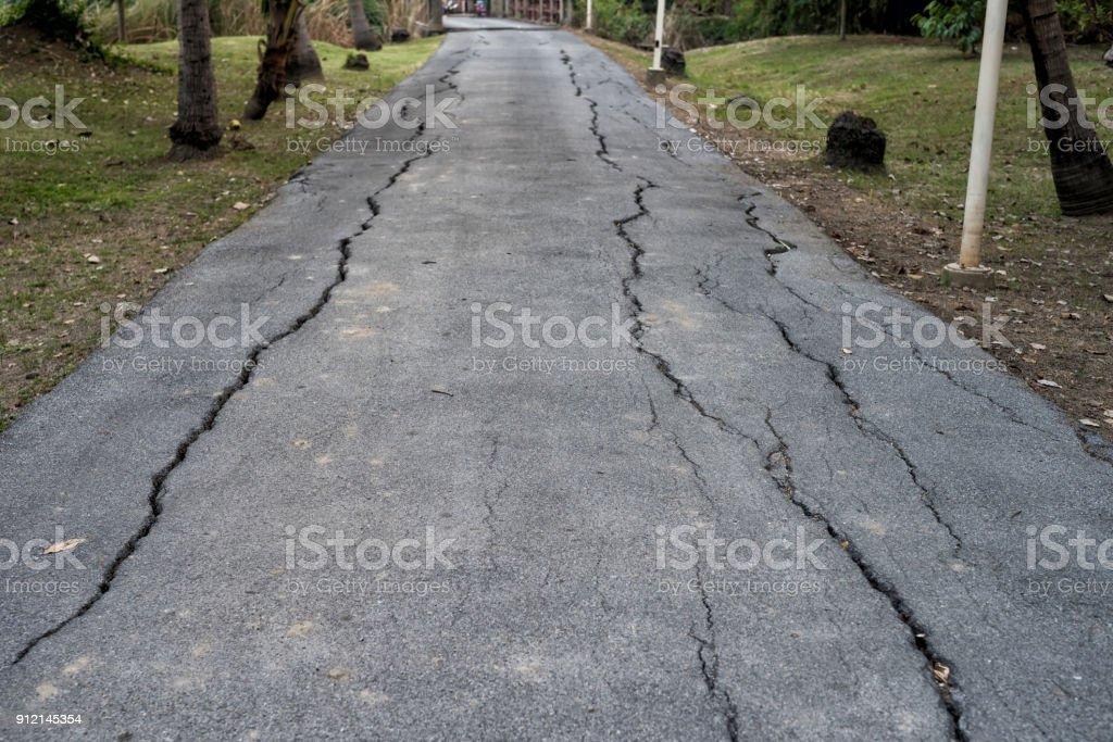 Cracked asphalt road after earthquake stock photo