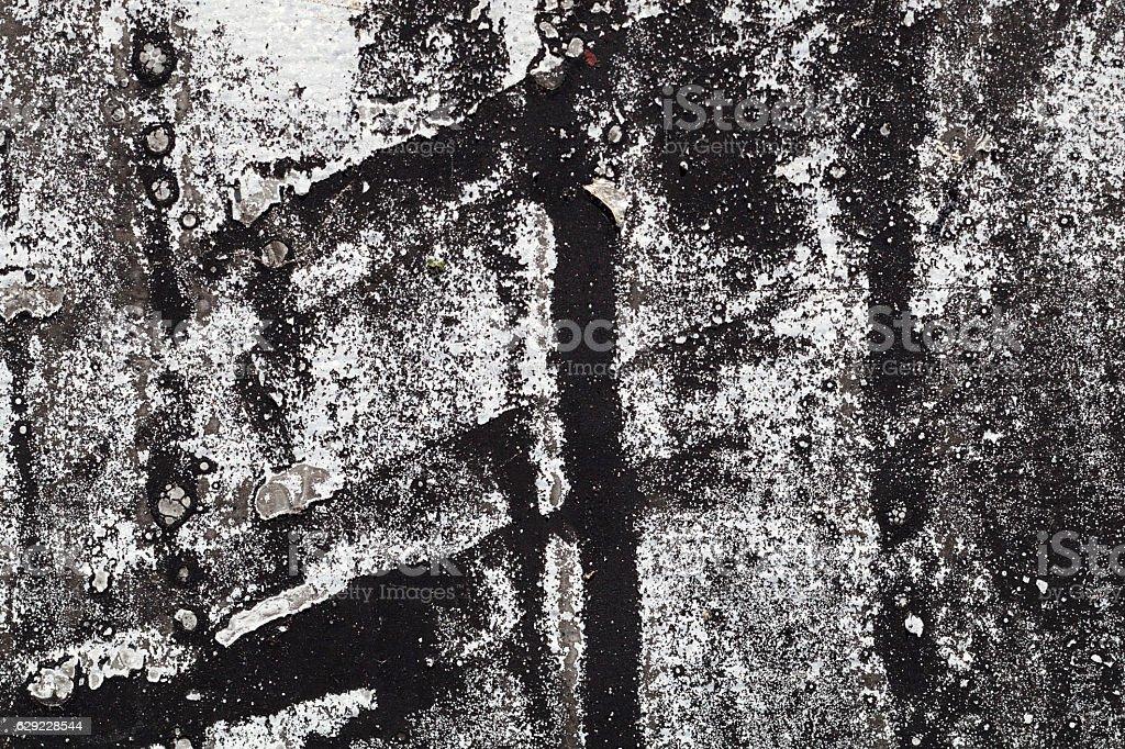 Cracked black and white paint on grunge metal  - macro stock photo