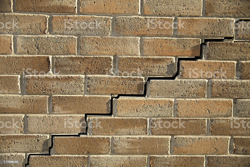 A cracked brown brick wall texture background royalty-free stock photo