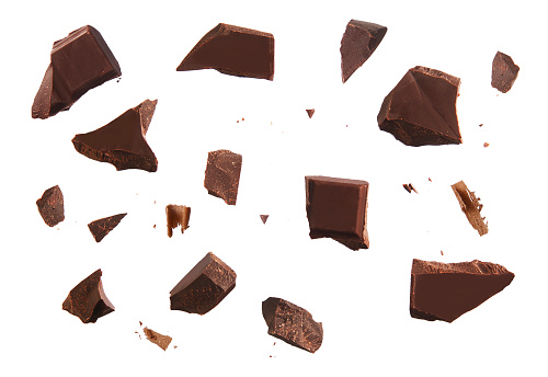 Cracked chocolate parts from top view isolated on white background