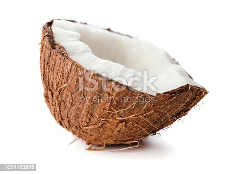 halves of cracked coconut isolated on white background