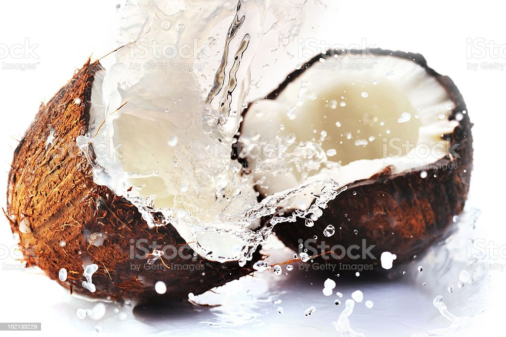 cracked coconut with splash royalty-free stock photo
