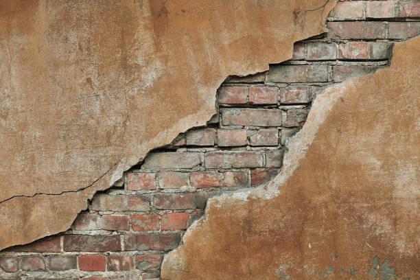 Cracked concrete vintage brick wall stock photo