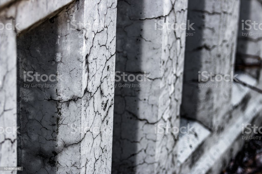Cracked damaged bridge pillars abstract stock photo