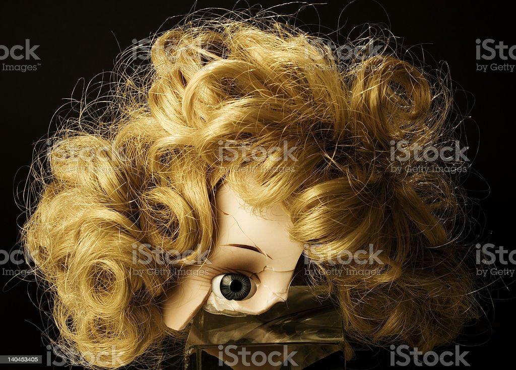Cracked doll stock photo
