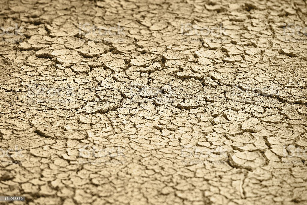 Cracked dry earth - natural background royalty-free stock photo
