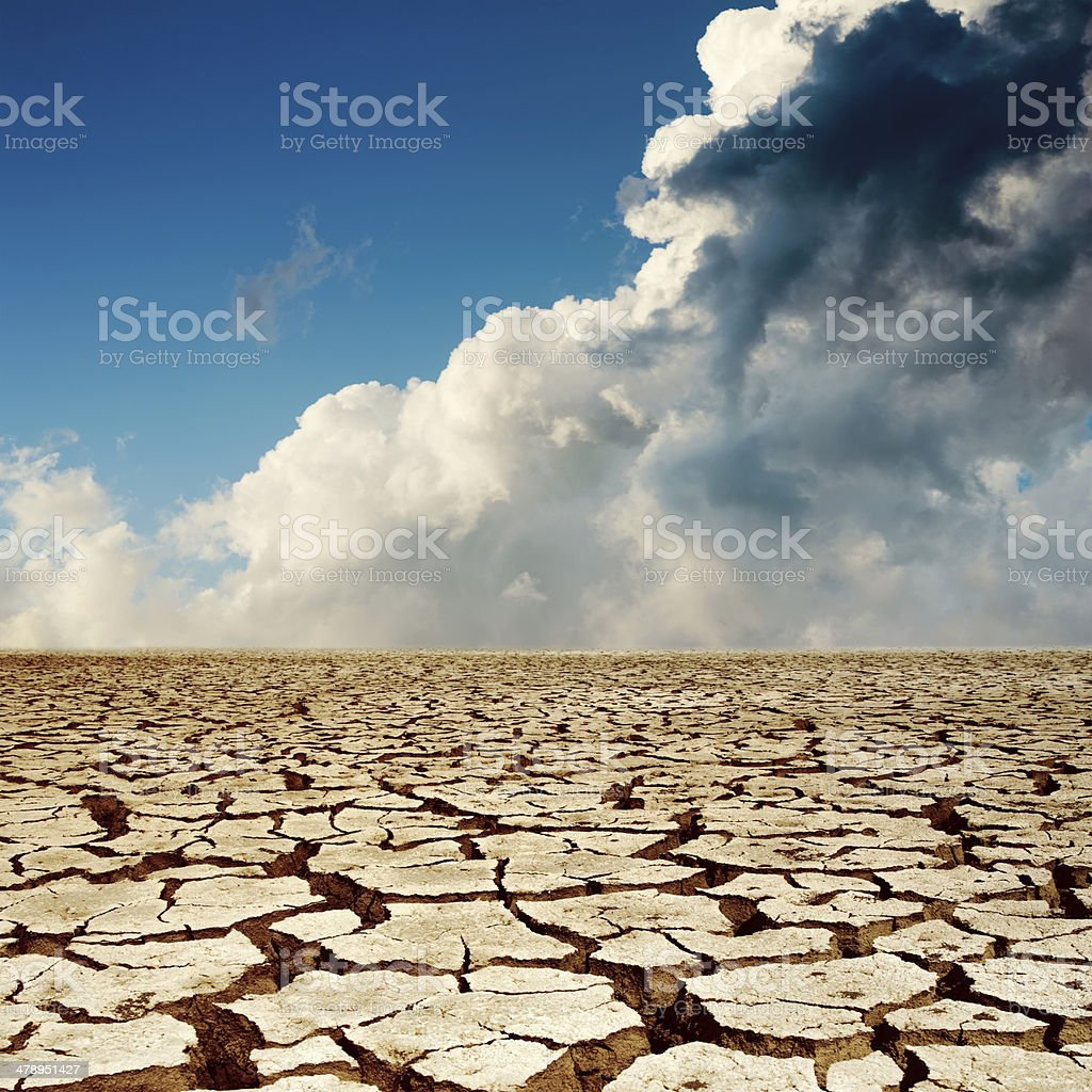 cracked earth and dramatic sky stock photo