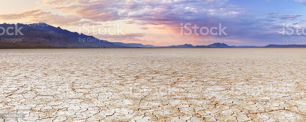 Cracked earth in remote Alvord Desert, Oregon, USA at sunset stock photo