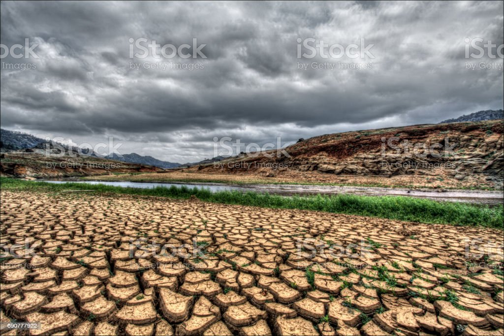 Cracked Earth of River Bank in Drought stock photo