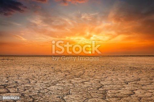 istock Cracked earth soil sunset landscape 856939024