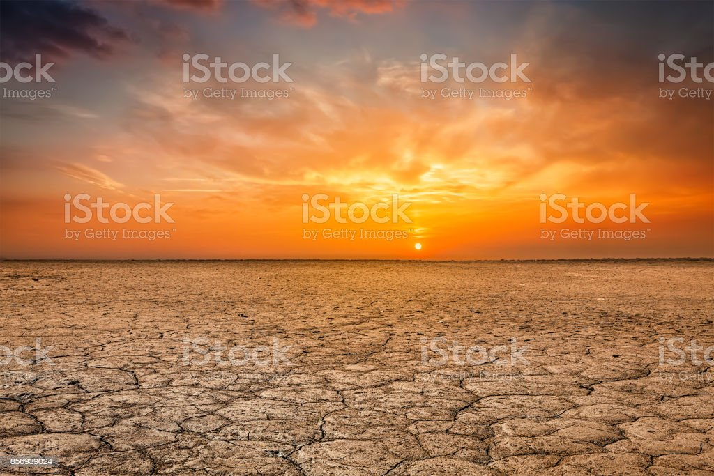Cracked earth soil sunset landscape stock photo
