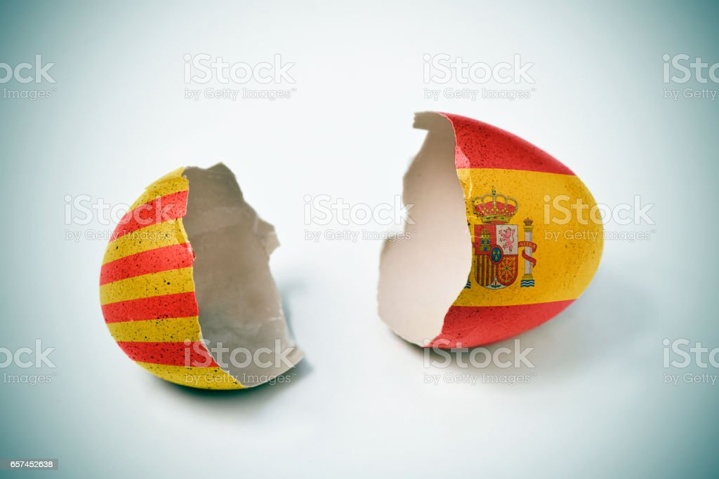 cracked eggshell with Catalan and Spanish flags stock photo