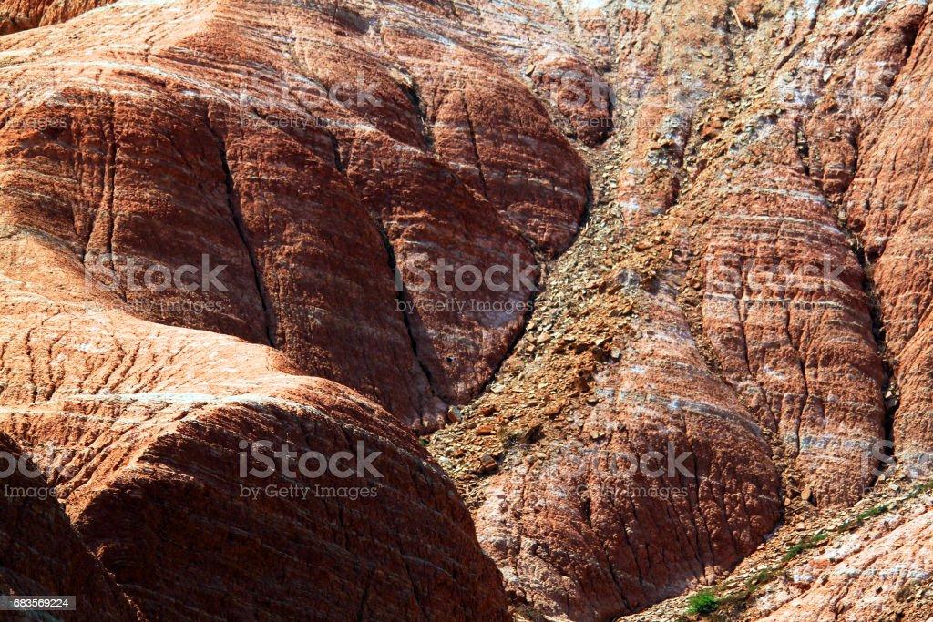 Cracked eroded rainbow mountain slopes stock photo
