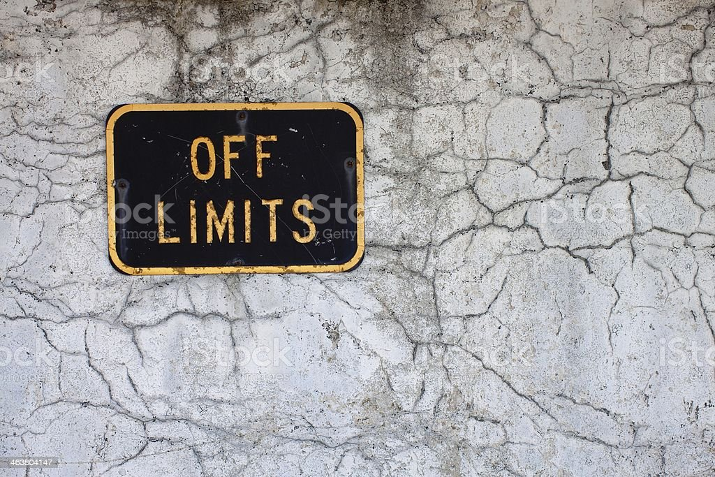 Cracked Exterior wall with old off limits sign. royalty-free stock photo