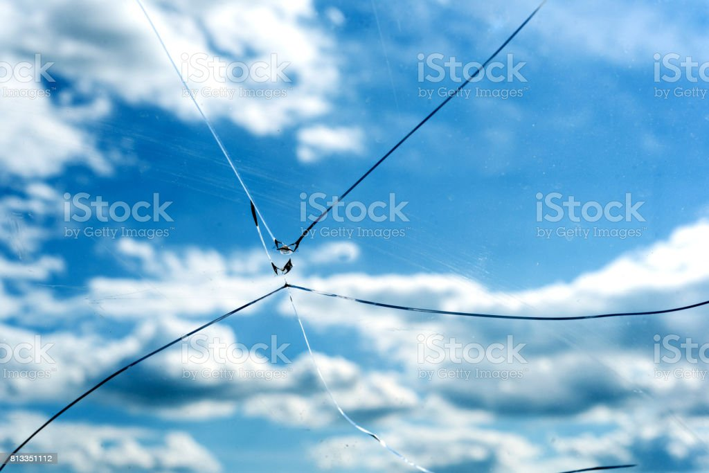 Cracked Glass Window Blue Sky stock photo
