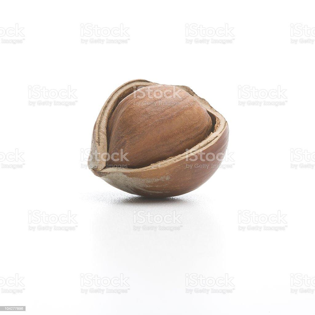 Cracked hazelnut isolated on a white royalty-free stock photo
