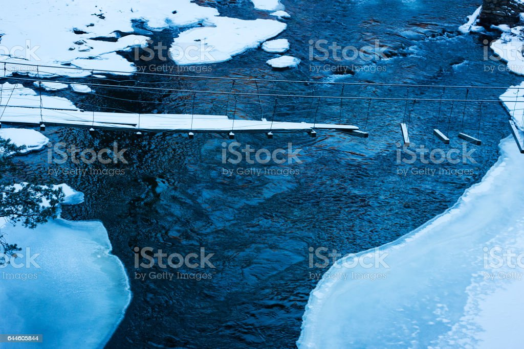 Cracked ice on the river - winter scenery stock photo