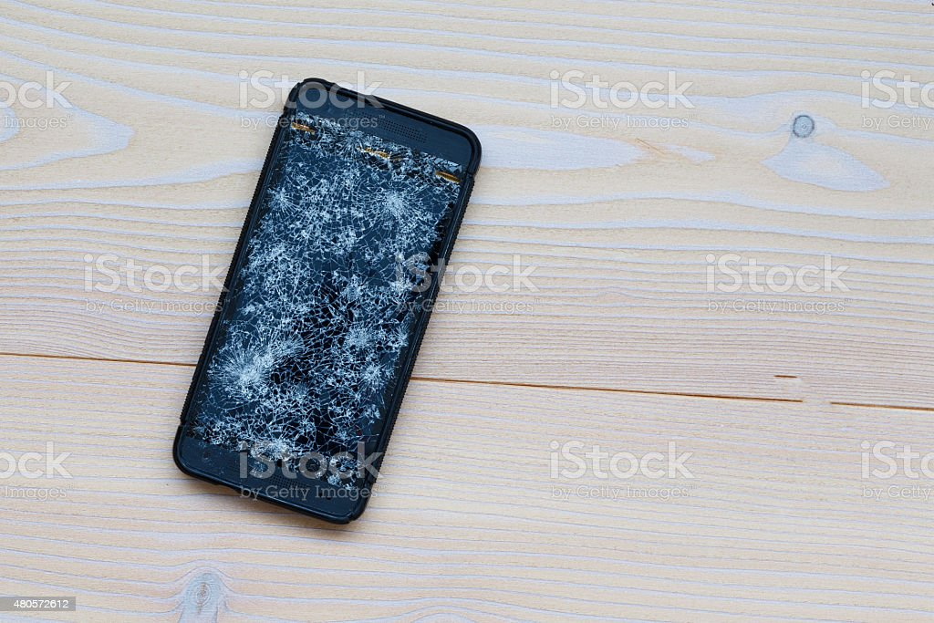 Cracked mobile phone stock photo
