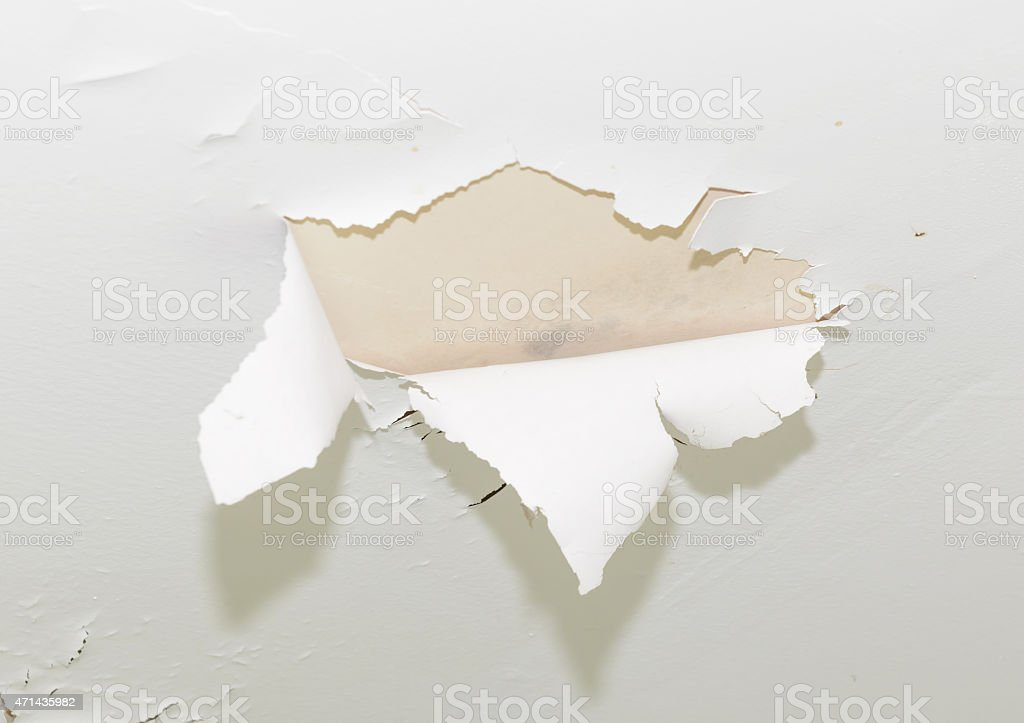 cracked paint on ceiling stock photo