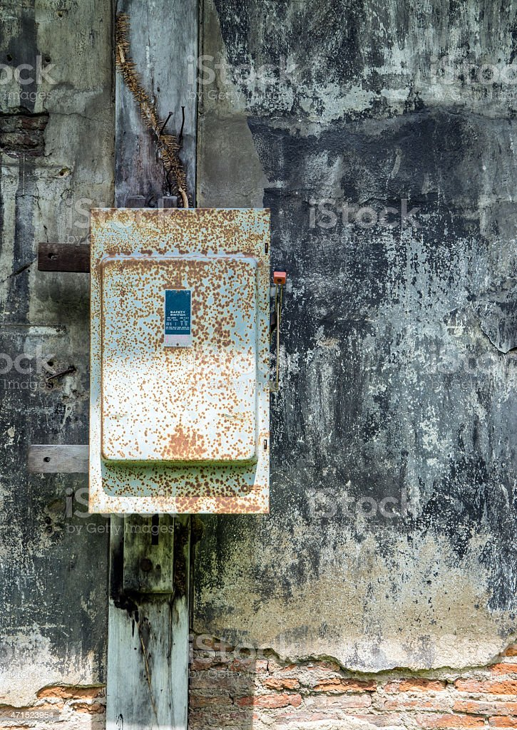 cracked painting stone wall with rusty fuse box picture id471523954 cracked painting stone wall with rusty fuse box stock photo fuse box training at alyssarenee.co