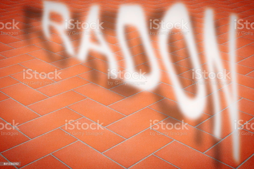 A cracked pavement with radon gas escaping - concept image with copy space stock photo