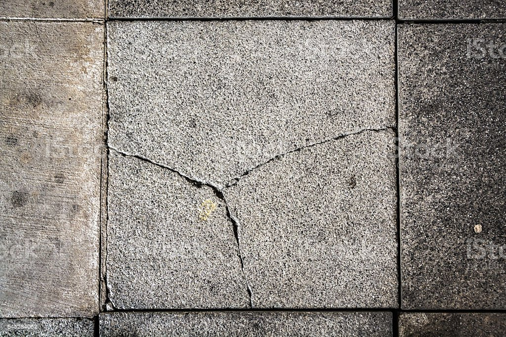 Cracked paving block - abstract texture background stock photo