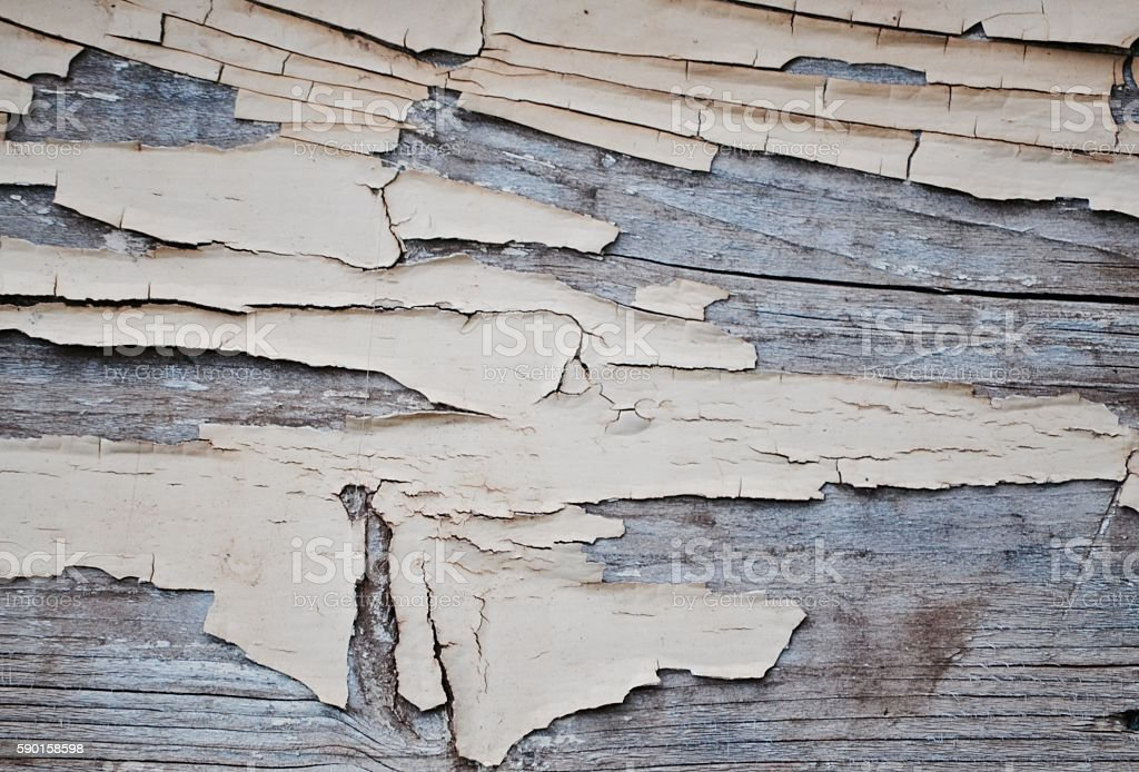 Cracked peeling paint on weathered wooden board background stock photo