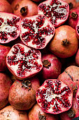 A bunch of pomegranates stacked together.