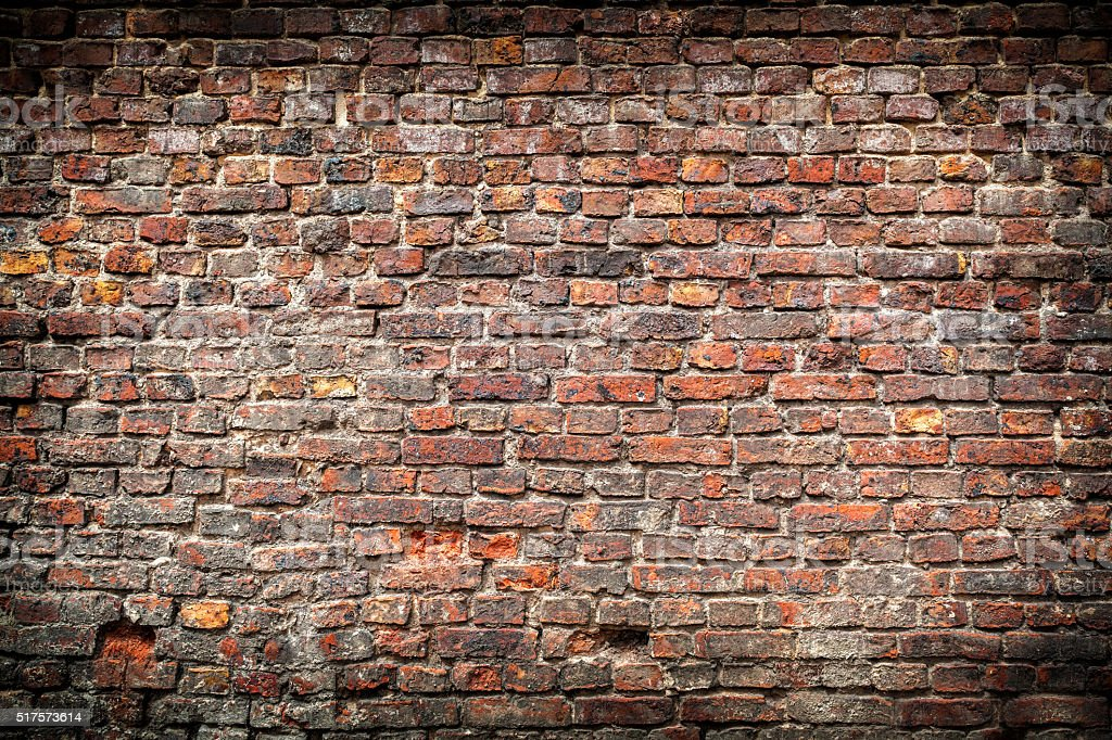 Cracked red brick wall background stock photo