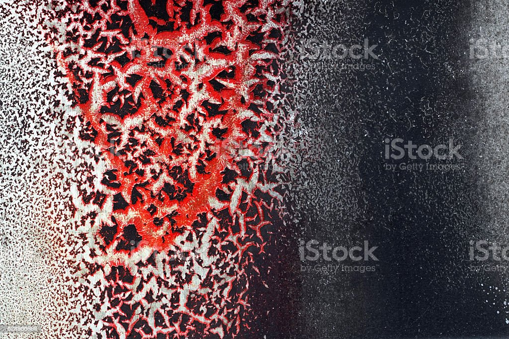Cracked red paint on grunge metal surface - macro 12 stock photo