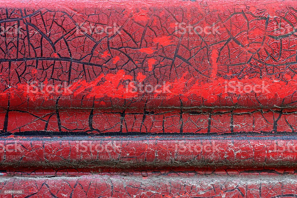 Cracked red paint on grunge metal surface - macro 13 stock photo