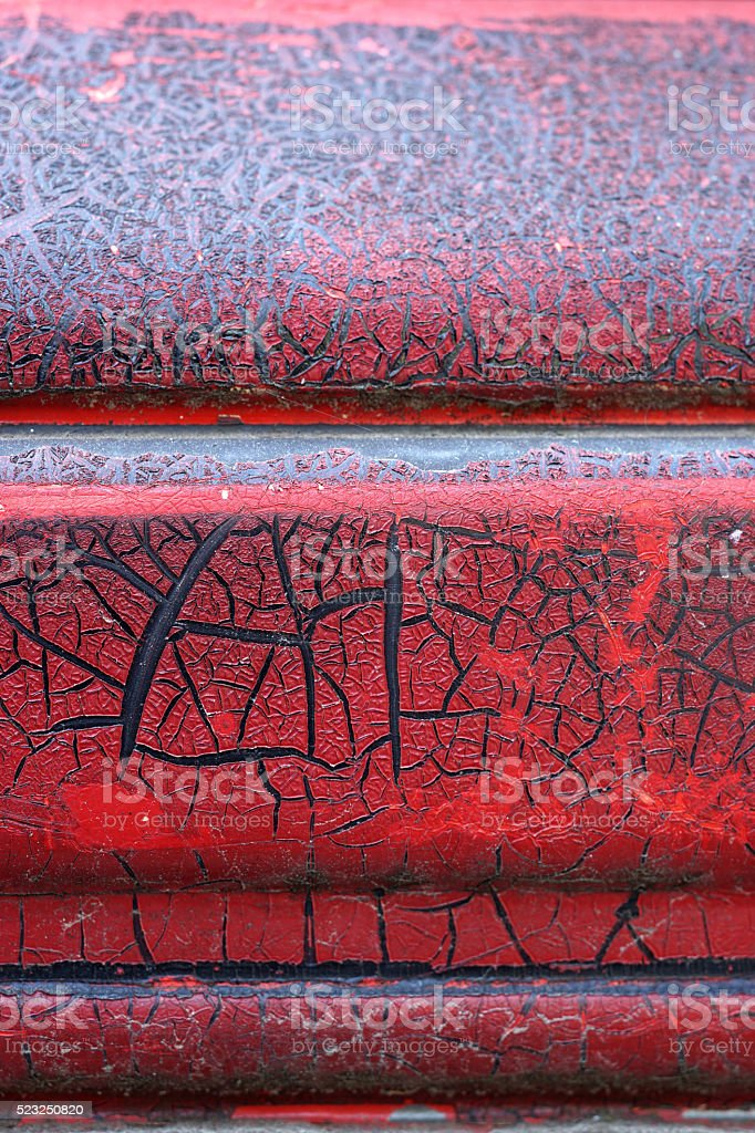 Cracked red paint on grunge metal surface - macro 14 stock photo