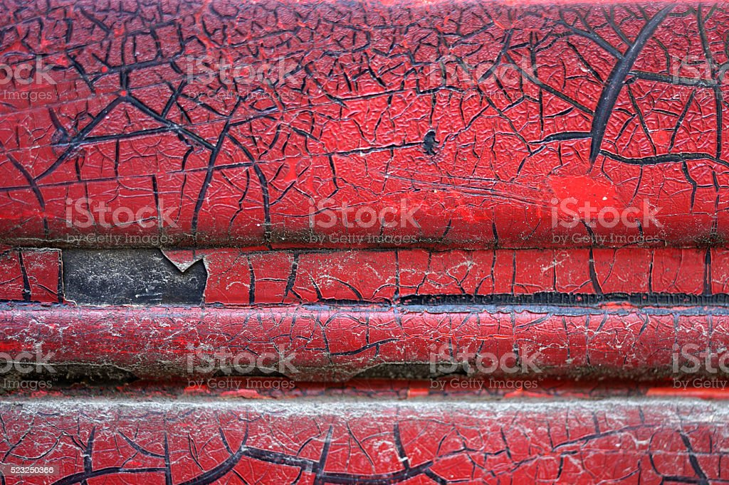 Cracked red paint on grunge metal surface - macro 15 stock photo