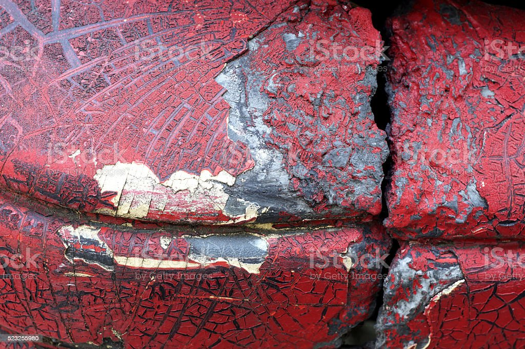 Cracked red paint on grunge metal surface - macro 3 stock photo