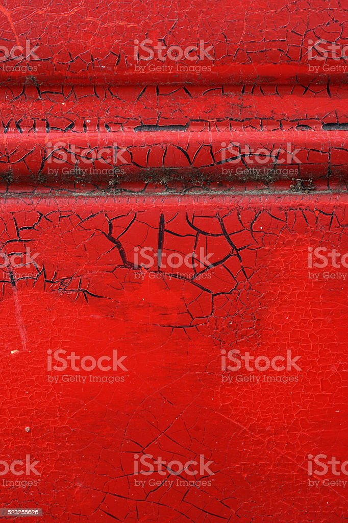 Cracked red paint on grunge metal surface - macro 4 stock photo