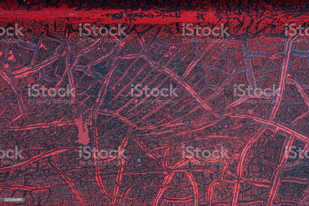 Cracked red paint on grunge metal surface - macro 6 stock photo