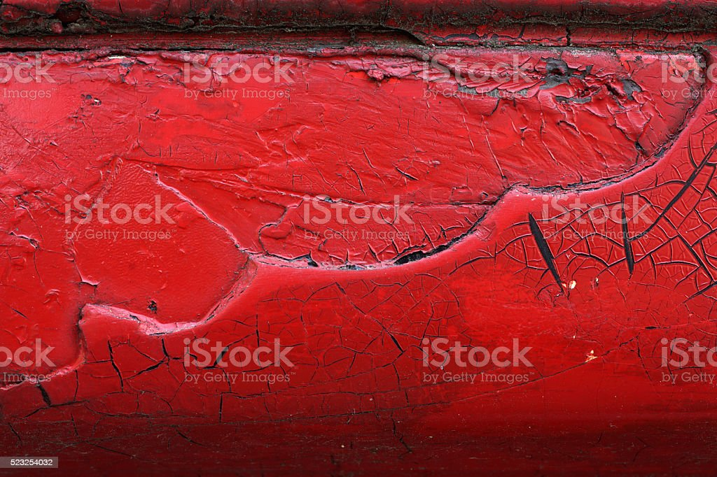 Cracked red paint on grunge metal surface - macro 8 stock photo