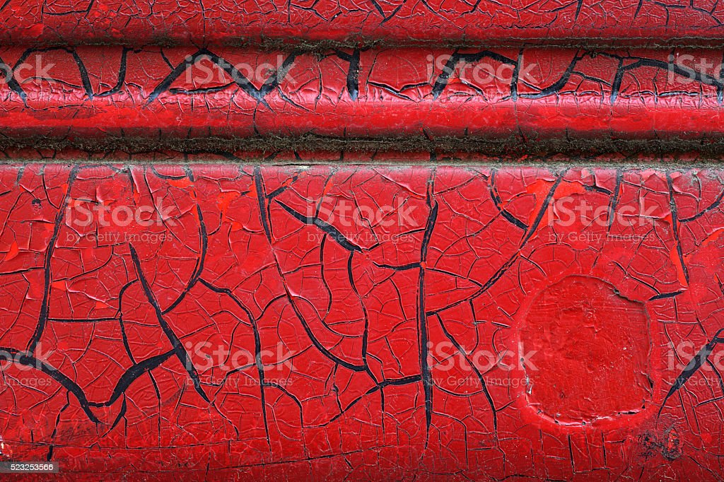 Cracked red paint on grunge metal surface - macro 9 stock photo