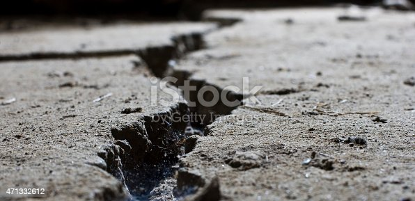istock cracked road concrete close up 471332612