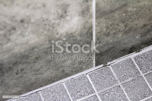 istock Cracked Shower Wall Corner Grout 656343052