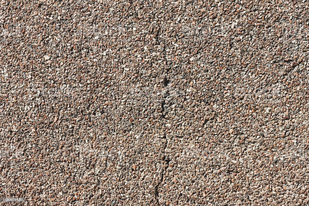 Cracked small granite wall background stock photo