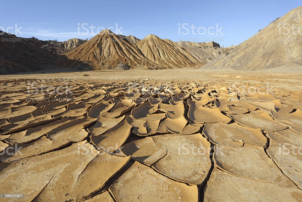 Cracked soil in the desert stock photo