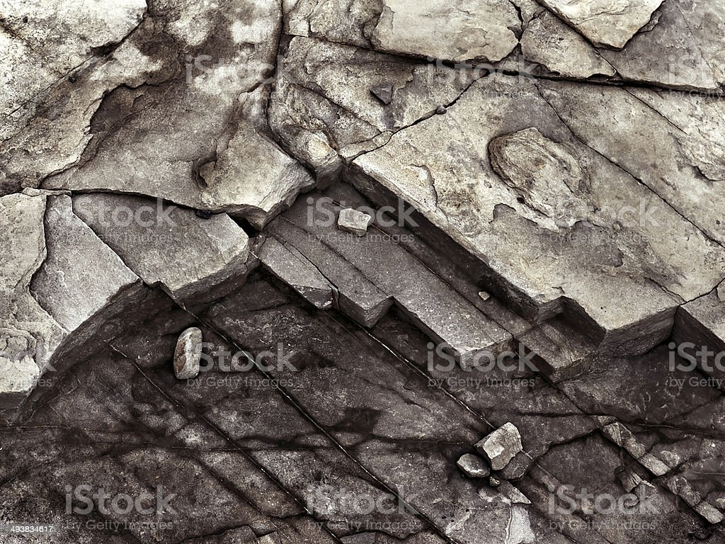 cracked stone rock in the style of grunge stock photo