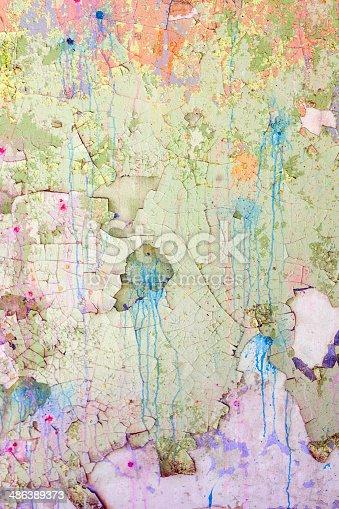 istock Cracked stone wall background 486389373