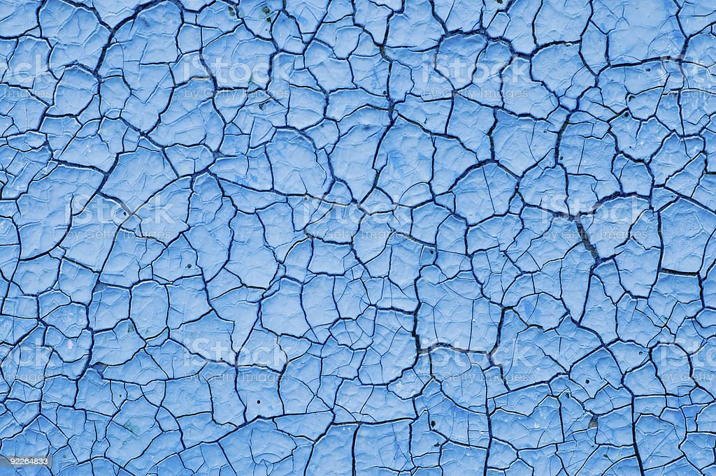 Cracked surface of blue paint background stock photo